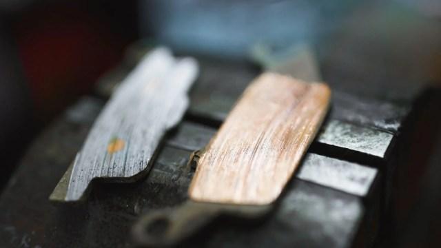 Worn brake pads.