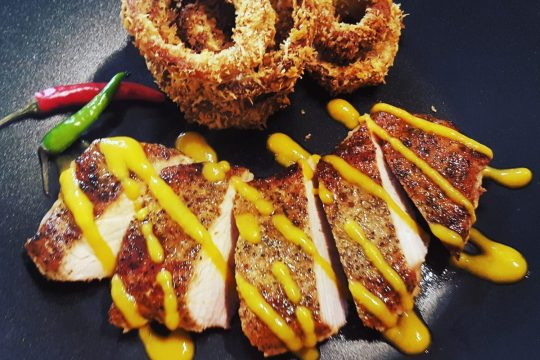 Cajun chops with papaya hot sauce and baked onion rings