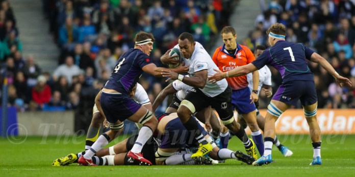 Leone Nakarawa bursting through the Scots' defence. © J. L. Preece