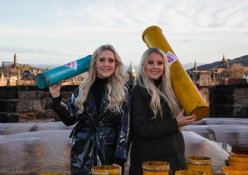 Blond twins with fireworks tubes