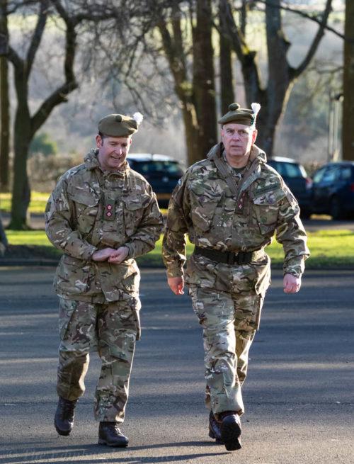 HRH The Duke of York KG walking with officer