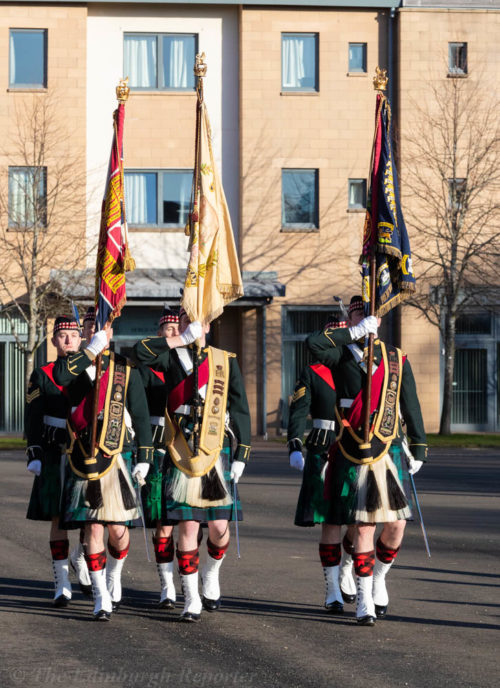 Regimental standards carried by kilted soldiers