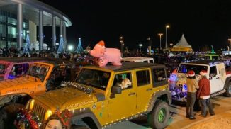 This lighted Jeep Parade was a fun way to raise money for Toys for Tots.