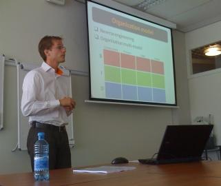 Johan den Haan presenting an Enterprise Ontology based approach to Model-Driven Engineering