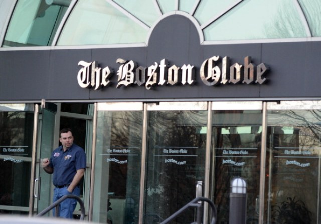 A man walks out of The Boston Globe on Feb. 20, 2013 in Boston. (Darren McCollester/Getty Images)