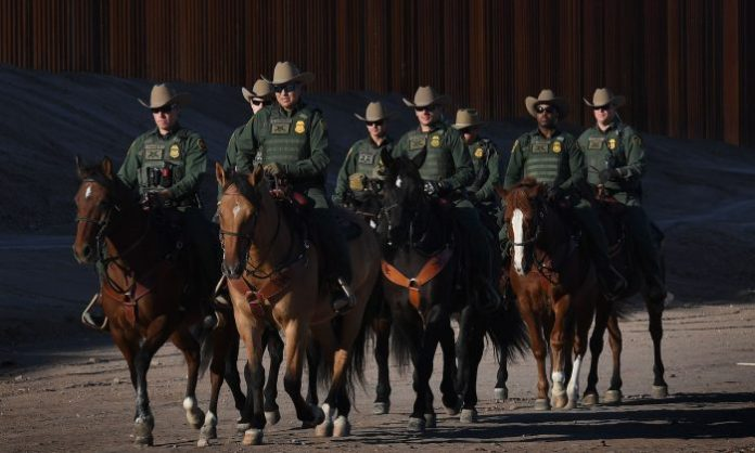 Mounted Border Patrol officers patrol before U.S. Department of Homeland Security Secretary Kirstjen M. Nielsen inaugurates the first completed section of President Trump's 30-foot border wall in the El Centro Sector, at the US Mexico border in Calexico, Calif. on Oct. 26, 2018. (Mark Ralston/AFP/Getty Images)
