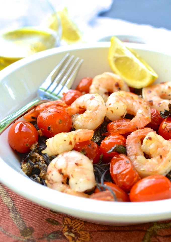 Roasted Cherry Tomatoes with Shrimp over Black Bean Spaghetti. Get the recipe at www.mybottomlessboyfriend.com