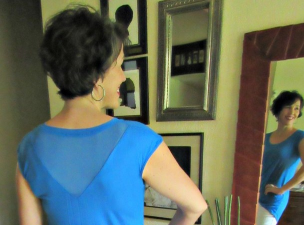 cerulean blue top with a mesh back cut-out