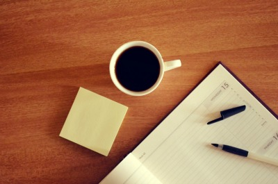 desk, planner, post-its and coffee