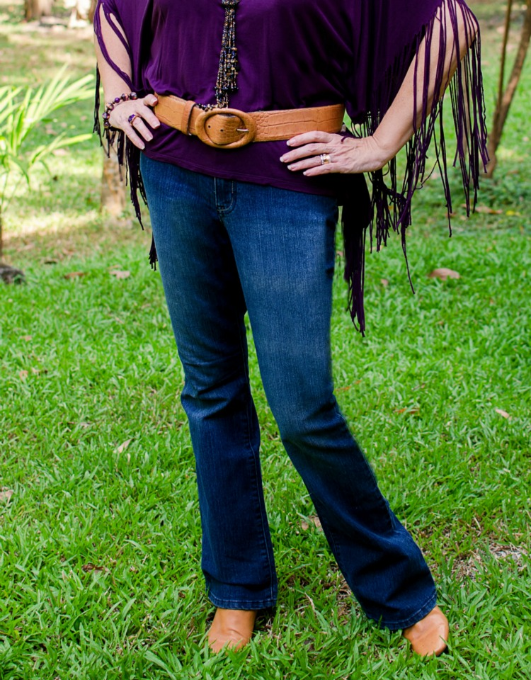 wearing color over 40, purple fringed poncho