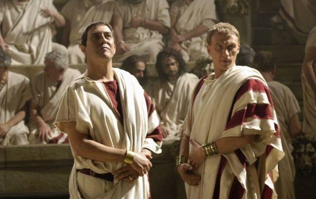 Two men wearing classic Roman Tongas.