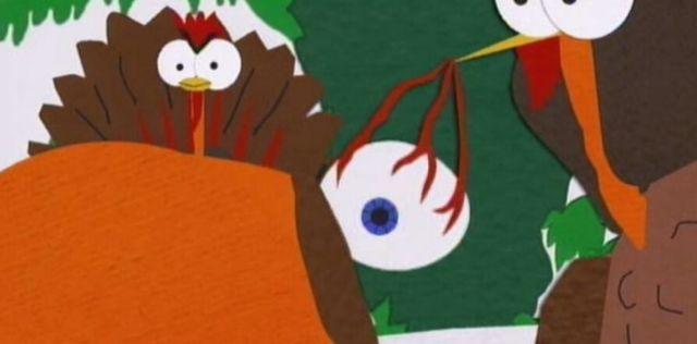 Kenny's blue eye being held by a turkey.