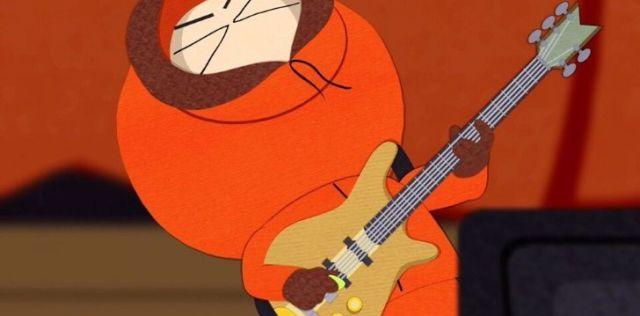 Kenny rocking a guitar.