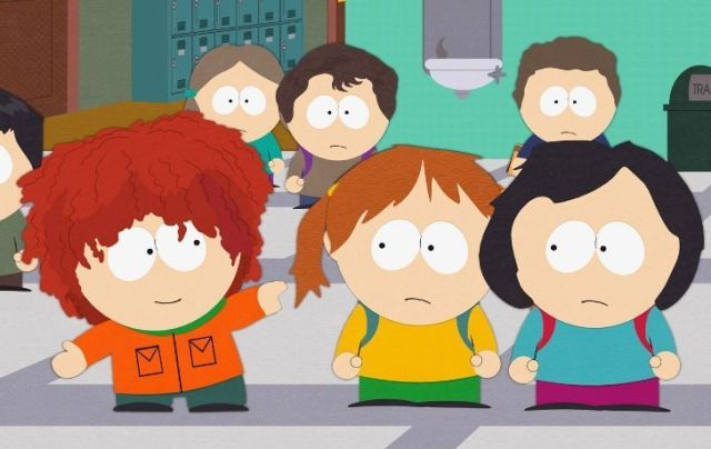 Kenny sporting a wig.