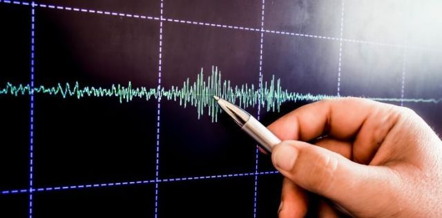A line graph to show seismic activity. The line shows a gradual buildup of seismic activity which then tapers off back to normal.