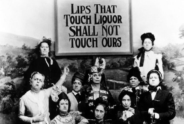 Women standing up against people drinking alcohol