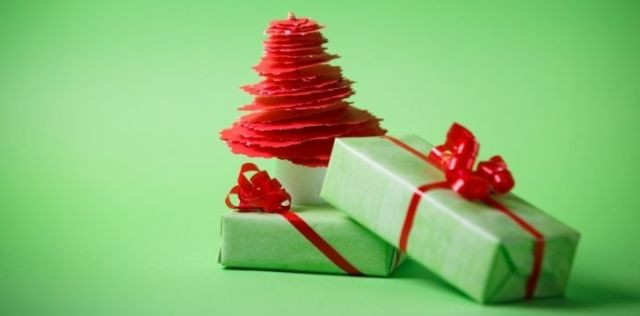 Two gifts wrapped in green paper with red ribbons