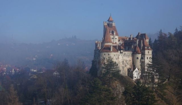Dracula castle surrounded with fogs