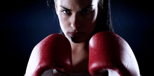 A female fighter in boxing gloves