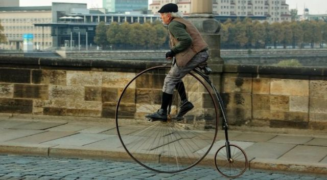 The penny farthing bicycle with a large front wheel and small back wheel