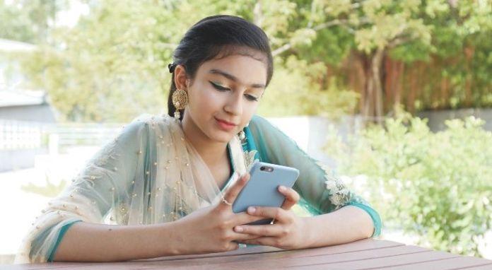 A Pakistani woman on her phone