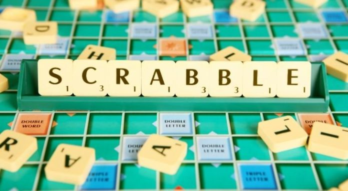"""A Scrabble board and tiles spelling out """"SCRABBLE"""""""