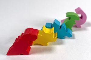 five dinosaur meeples