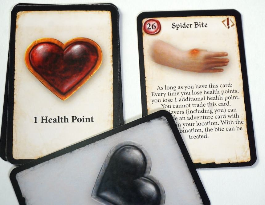 "Cards: ""1 Health Point"" and ""Spider Bite"""