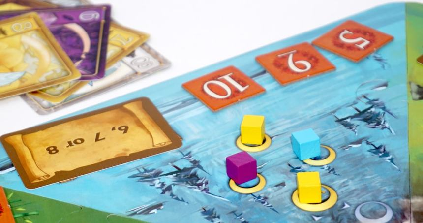 Yellow, purple, and blue tokens on a blue kingdom