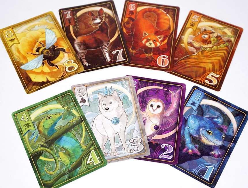 Animal cards numbered 1-8: Dart Frog, Barn Owl, Arctic Wolf, Anole Lizard, Bengal Tiger, Red Panda, Okapi, Honeybee