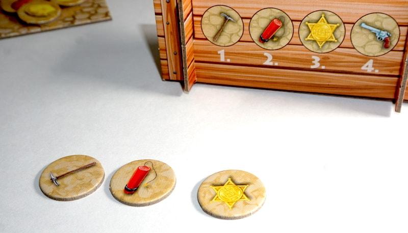 Action tiles: pick, dynamite, star.