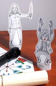 Two paper statues, a flashlight, and a decoder wheel