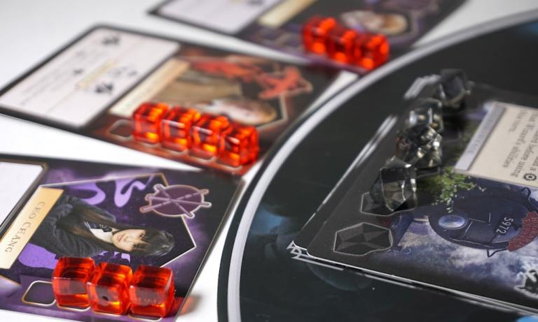 Death Eaters Rising character and location cards full of damage/corruption tokens.
