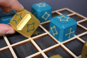 Deblockle - rolling a gold cube star-side up onto the star space.