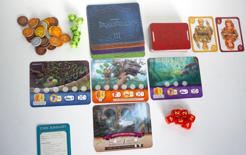 coins, dragonrealm location cards, number cards, and dice.