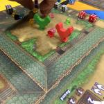 Dice, plastic gems, and wooden chicken meeples
