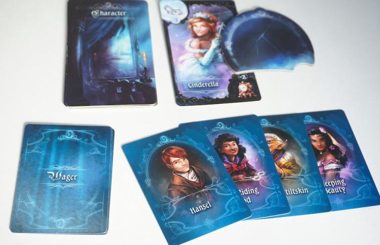 Cinderella character card. Wager cards: Hansel, Red Riding Hood, Rumplestiltskin, Sleeping Beauty.