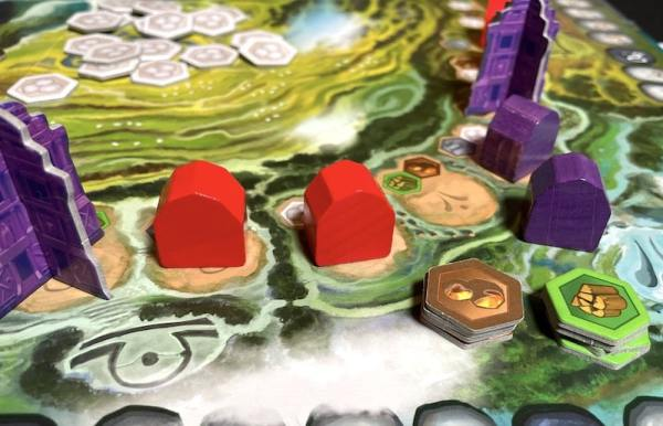 Line of red huts and purple huts. One hut is pushed out of the line, sitting next to stacks of resource tokens for gold and wood.