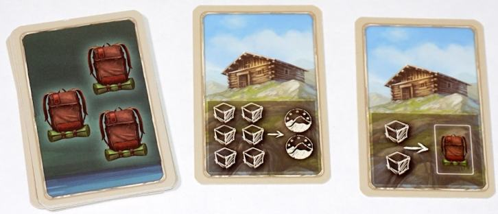 Stack of 3-item cards. Two face up cards show mountain huts. The first has 6 cubes and 2 stamps, the second has 2 cubes and an equipment card.