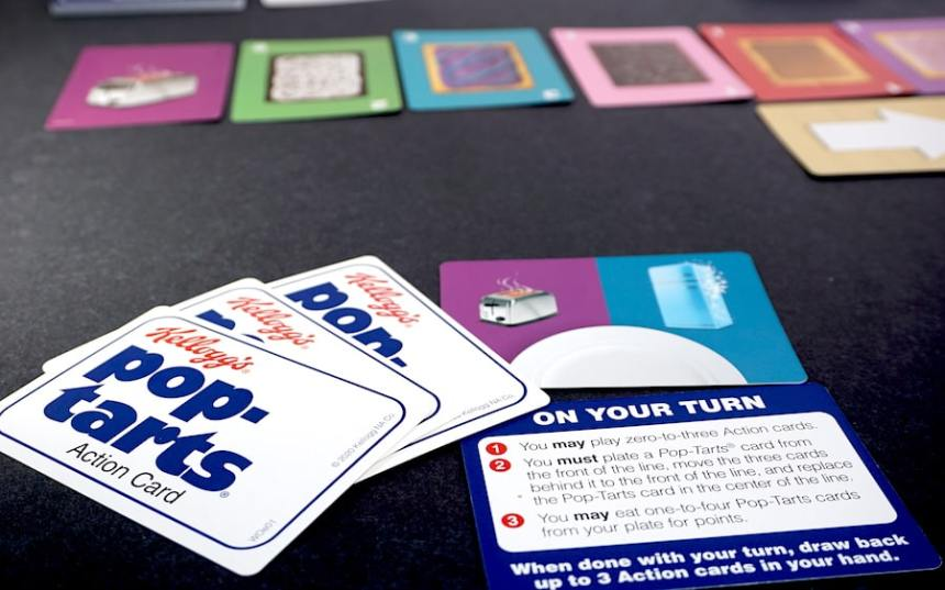 Pop-Tarts hand of 3 action cards and a plate card showing a toaster and a freezer.