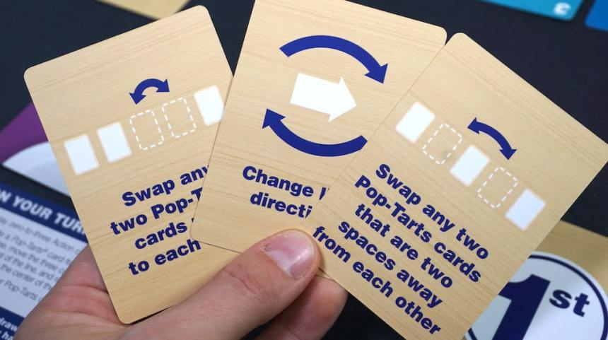 Action cards: Swap any two Pop-Tarts cards next to each other; Change line direction; Swap any two Pop-Tarts cards that are two spaces away from each other