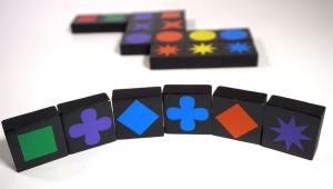 Qwirkle hand: green square, purple cross, blue diamond, blue cross, red diamond, purple starburst