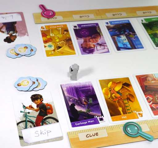 "Two player boards. Lila has focus token on ""Game Pieces"" object card. Skip has focus token on ""Hat"" object card."