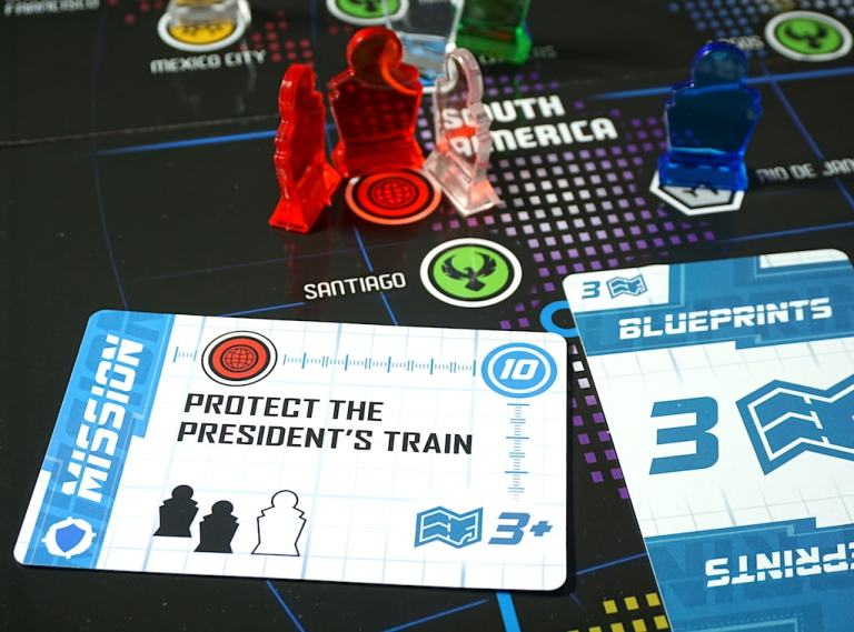 Spymaster mission card on the board.  2 red pawns and one clear pawn in Lima.