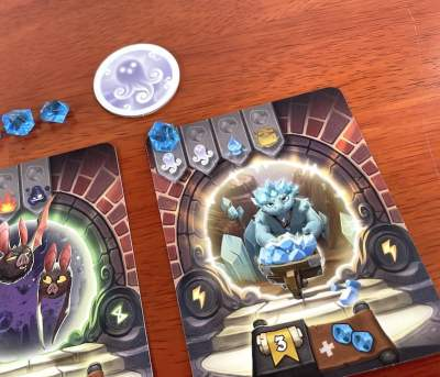Crystal creature in Via Magica with one crystal placed on the first spot on the card