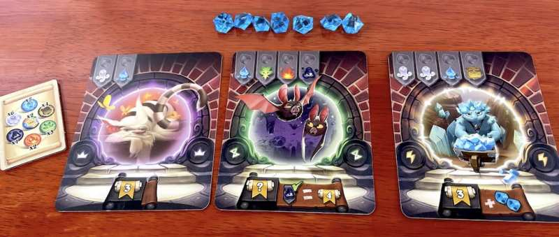 Three Via Magica portal cards: cat (3 points, no effect), bats (4 points for each dark Animus), crystal creature (3 points and 2 additional crystals)