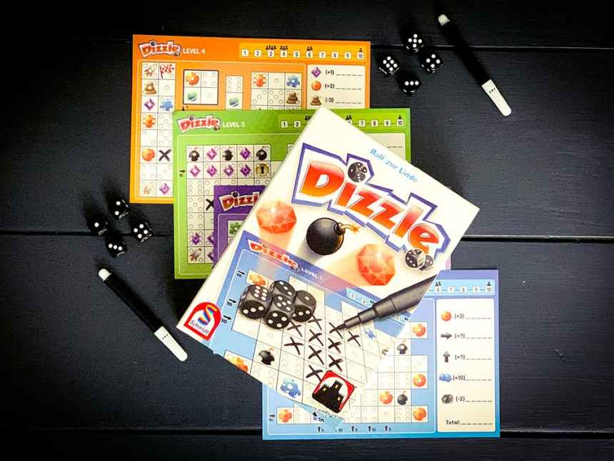 Dizzle box with player sheets, markers, and dice