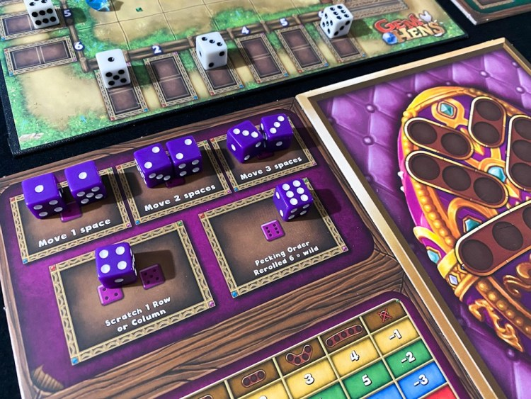 Purple dice on the Gem Hens action board. Two each in move 1, move 2, move 3, one in the scratch action, and one in the pecking order action.