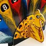 Pikoko yellow peacock holding feather cards