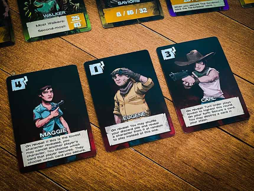 On reveal abilities - Maggie: If this is the lowest character revealed, you may cancel another player's character. You choose which card that player secures. They choose which card you secure. Eugene: You may shuffle your discard pile and reveal a character from it at random to play instead of this one. Carl: Turn order plays lowest to highest this round...